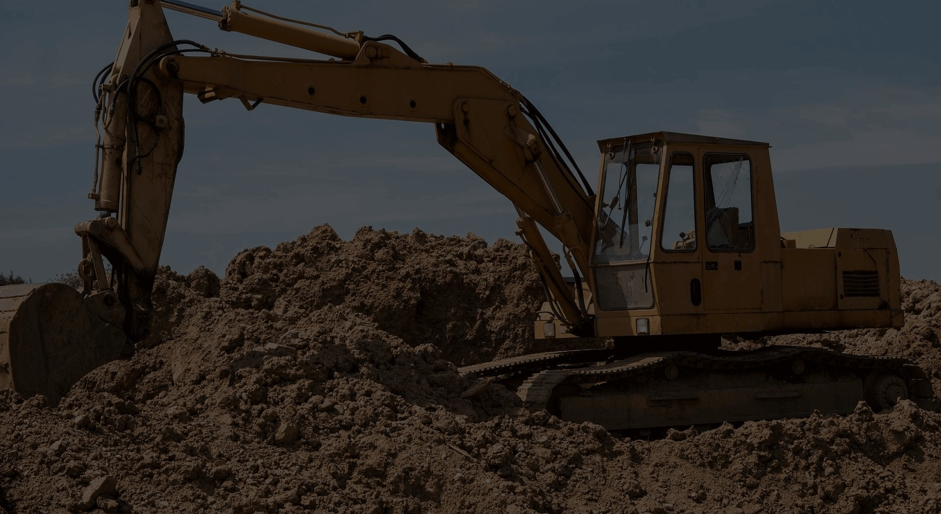 Image of a Construction Vehicle Moving Dirt